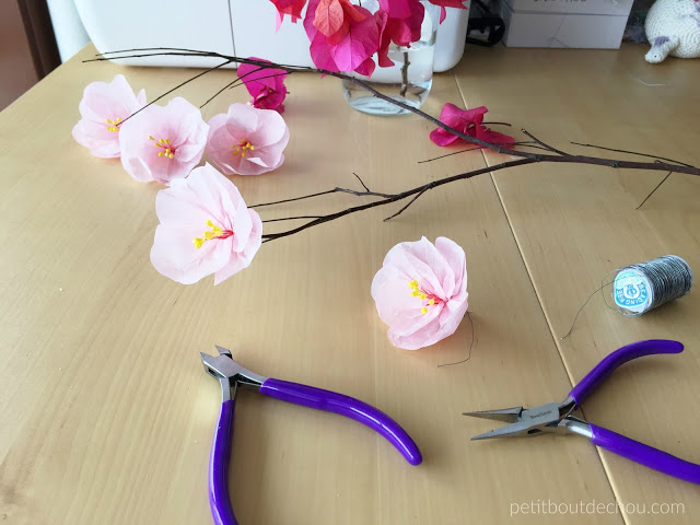 plum blossom flowers and branch with wire
