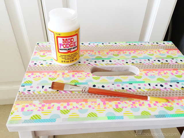 apply mod podge to seal washi tape on step stool