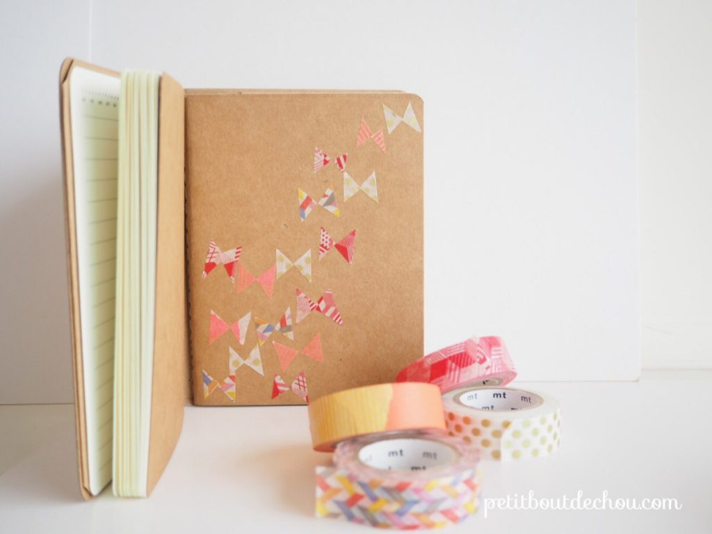 notebook decorated with masking tape butterflies